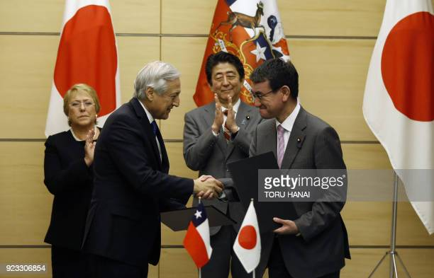 Chile's Foreign Minister Heraldo Munoz shakes hands with Japan's Foreign Minister Taro Kono as they exchange documents on the JapanChile Partnership...