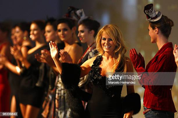 Chile's former Miss Universe Cecilia Bolocco greets the audience during the Apology fashion show on April 8 2010 in Santiago Chile Bolocco is the...