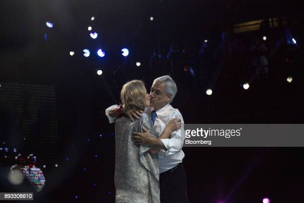 Chile's Former President Sebastian Pinera presidential candidate for the National Renewal party kisses his wife Cecilia Morel during a final campaign...