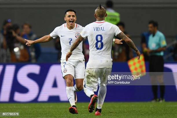 TOPSHOT Chile's forward Alexis Sanchez and Chile's midfielder Arturo Vidal celebrate winning the match in the penalty shoot out during the 2017...
