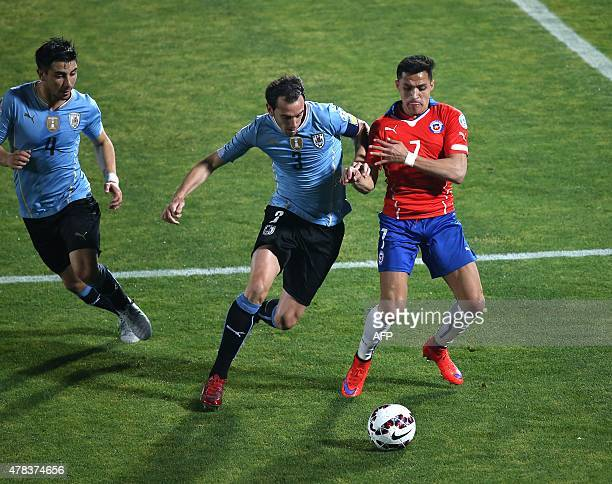 Chile's forward Alexis Sanchez and Uruguay's defender Diego Godin vie for the ball during their 2015 Copa America football championship quarterfinal...