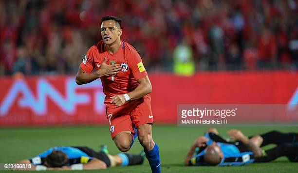 TOPSHOT Chile's forward Alexis Sanchez celebrates after scoring against Uruguay during their 2018 FIFA World Cup qualifier football match in Santiago...
