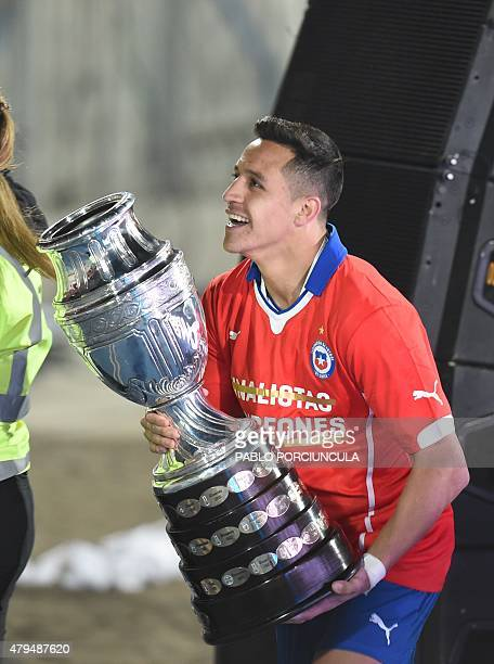 Chile's forward Alexis Sanchez celebrates with the trophy of the 2015 Copa America football championship in Santiago Chile on July 4 2015 AFP PHOTO /...