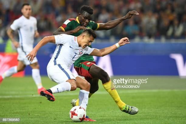 Chile's forward Alexis Sanchez challenges Cameroon's defender Michael NgadeuNgadjui during the 2017 Confederations Cup group B football match between...