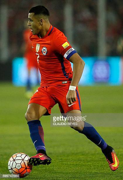 Chile's forward Alexis Sanchez drives the ball during the Russia 2018 World Cup football qualifier match against Bolivia in Santiago on September 6...