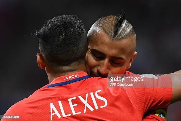 Chile's forward Alexis Sanchez is congratulated by Chile's midfielder Arturo Vidal after scoring a goal during the 2017 Confederations Cup group B...