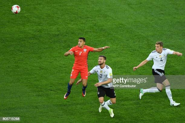 Chile's forward Alexis Sanchez jumps for the ball against Germany's defender Shkodran Mustafi during the 2017 Confederations Cup final football match...