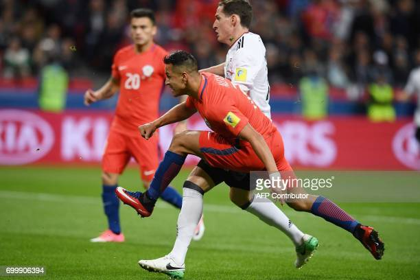 TOPSHOT Chile's forward Alexis Sanchez kicks to score a goal during the 2017 Confederations Cup group B football match between Germany and Chile at...