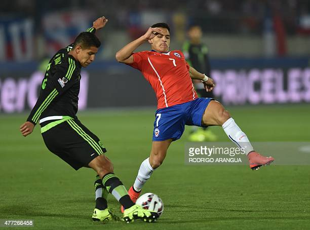 Chile's forward Alexis Sanchez marks Mexico's defender Hugo Ayala during their 2015 Copa America football championship match in Santiago on June 15...