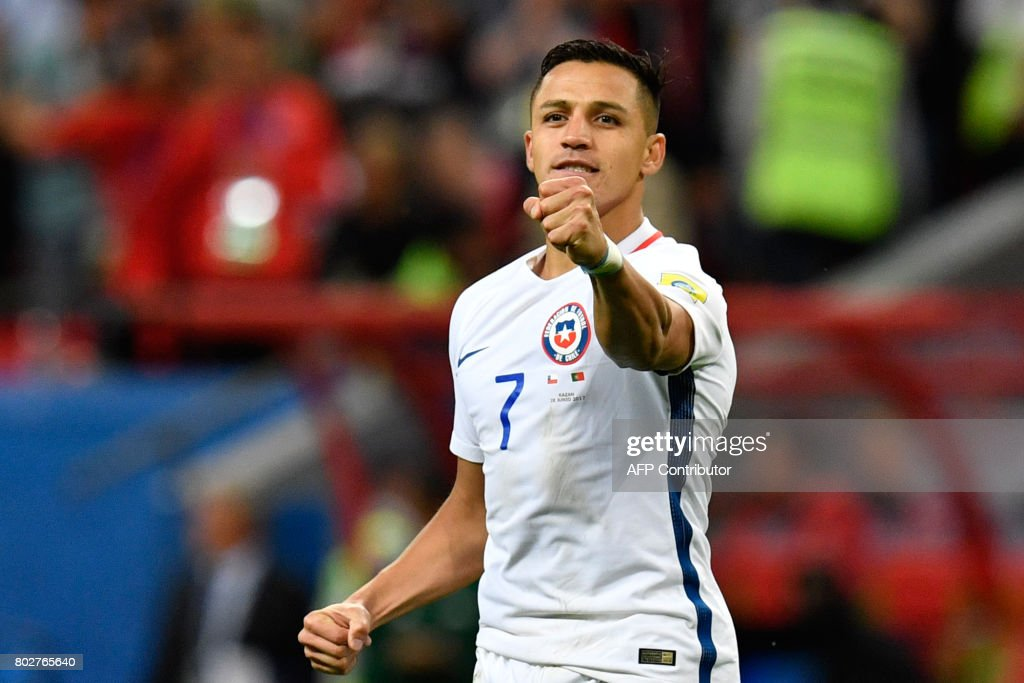 TOPSHOT - Chile's forward Alexis Sanchez reacts after scoring in the third ball of the penalty shoot out placing Chile into the finals during the 2017 Confederations Cup semi-final football match between Portugal and Chile at the Kazan Arena in Kazan on June 28, 2017. / AFP PHOTO / Alexander NEMENOV