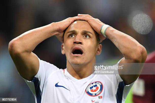 Chile's forward Alexis Sanchez reacts during the 2017 Confederations Cup semifinal football match between Portugal and Chile at the Kazan Arena in...