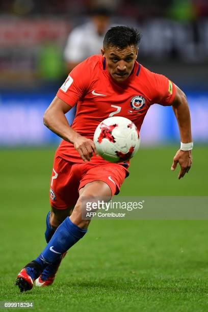 Chile's forward Alexis Sanchez runs with the ball during the 2017 Confederations Cup group B football match between Germany and Chile at the Kazan...