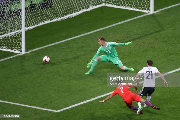 TOPSHOT Chile's forward Alexis Sanchez scores a goal past Germany's goalkeeper MarcAndre Ter Stegen during the 2017 Confederations Cup group B...