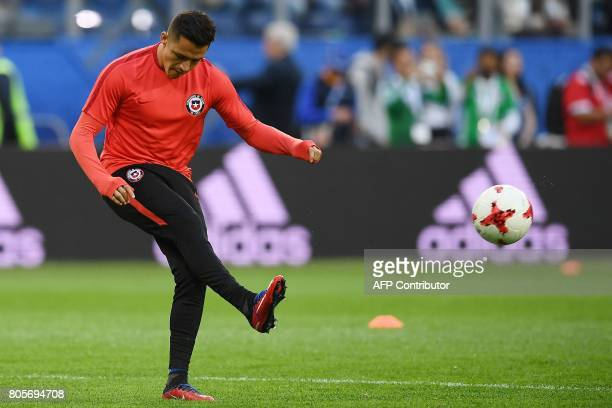 Chile's forward Alexis Sanchez warms up prior to the start of the 2017 Confederations Cup final football match between Chile and Germany at the Saint...