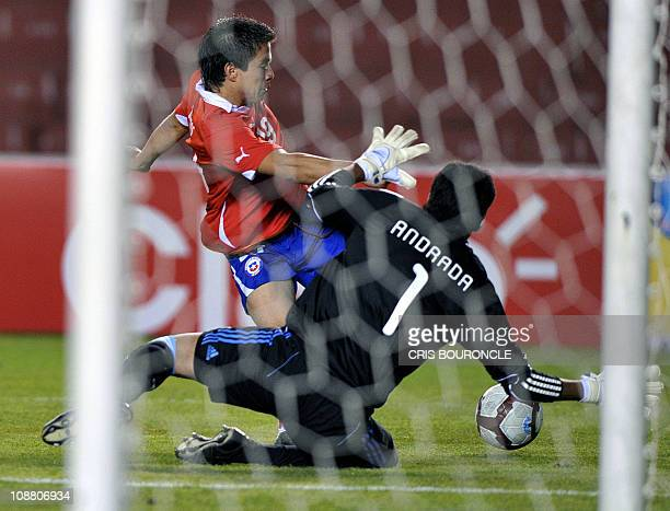 Chile's forward Alvaro Ramos is stopped by Argentina's goalkeeper Esteban Andrada during the South American Under20 championship second round...