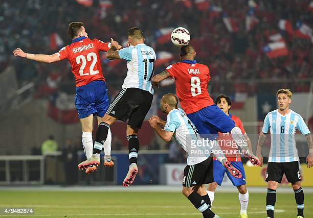 Chile's forward Angelo Henriquez Argentina's defender Nicolas Otamendi and Chile's midfielder Arturo Vidal jump for a header during their 2015 Copa...