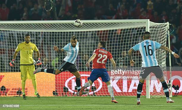 Chile's forward Angelo Henriquez vies for the ball with Argentina's defenders Nicolas Otamendi and Marcos Rojo during their 2015 Copa America...