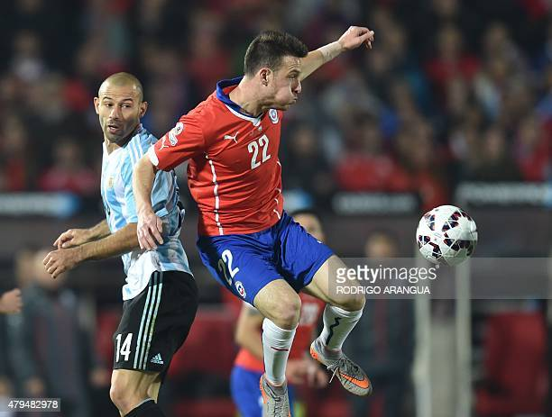 Chile's forward Angelo Henriquez vies for the ball with Argentina's midfielder Javier Mascherano during their 2015 Copa America football championship...