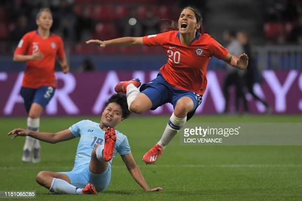 Chile's forward Daniela Zamora gets fouled by Thailand's forward Pitsamai Sornsai during the France 2019 Women's World Cup Group F football match...