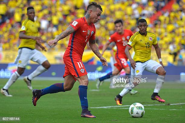 Chile's forward Eduardo Vargas prepares to shoot against Colombia's defender Farid Diaz during their 2018 FIFA World Cup qualifiers football match in...