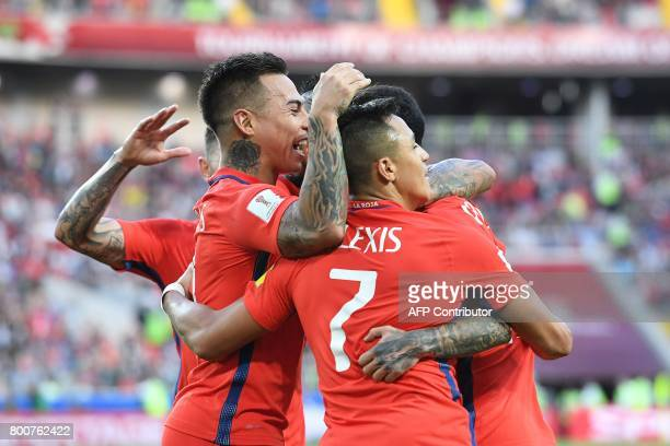 Chile's forward Martin Rodriguez celebrates after scoring a goal with team mates during the 2017 Confederations Cup group B football match between...