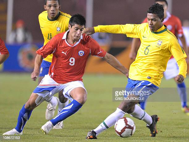 Chile's forward Yashir Pinto and Brazil's fullback Alex Sandro vie for the ball during a second round match of the Under20 South American...