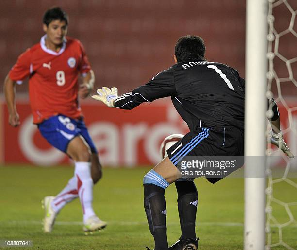 Chile's forward Yashir Pinto shoots at Argentina's goalkeeper Esteban Andrada's goal during a second round match of the Under20 South American...