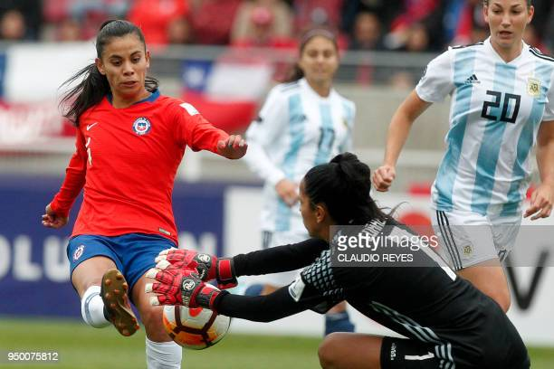 Chile's Francisca Lara vies for the ball with Argentina's goalkeeper Vanina Correa during the Women's Copa America match at La Portada stadium in...