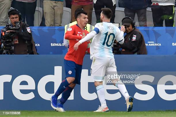 Chile's Gary Medel and Argentina's Lionel Messi have a physical encounter before both are sent off during their Copa America football tournament...