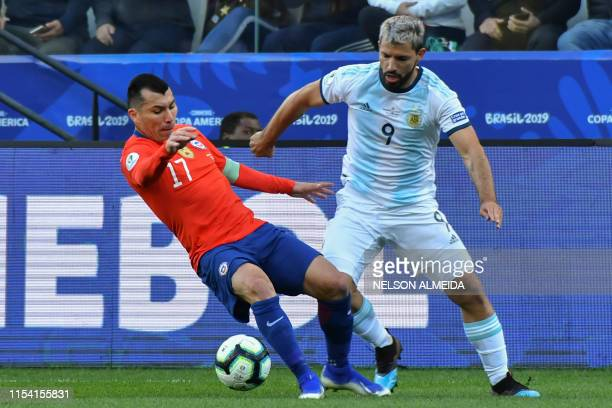 Chile's Gary Medel and Argentina's Sergio Aguero vie for the ball during their Copa America football tournament thirdplace match at the Corinthians...