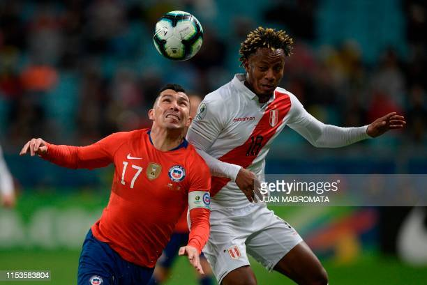 Chile's Gary Medel and Peru's Andre Carrillo vie for the ball during their Copa America football tournament semifinal match at the Gremio Arena in...