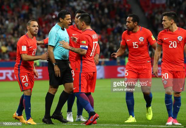 Chile's Gary Medel argues with referee Alireza Faghani during the Group B preliminary stage soccer match between Chile and Germany at the...