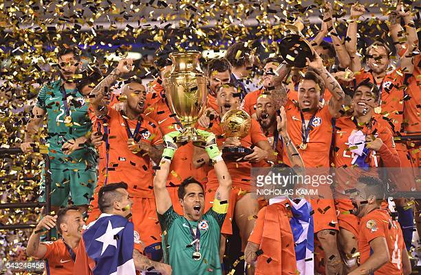 Chile's goalkeeper Claudio Bravo holds the trophy after winning the Copa America Centenario final by defeating Argentina in the penalty shoot-out in...