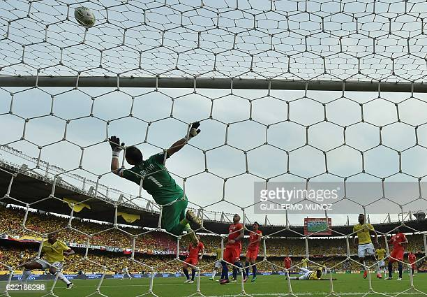 Chile's goalkeeper Claudio Bravo pulls off a save during the 2018 FIFA World Cup qualifier football match against Colombia in Barranquilla Colombia...