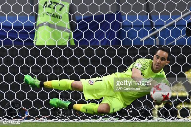 TOPSHOT Chile's goalkeeper Claudio Bravo stops a shoot by Portugal's forward Nani during the penalty shoot out during 2017 Confederations Cup...