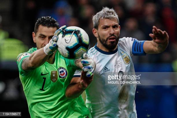 TOPSHOT Chile's goalkeeper Gabriel Arias and Argentina's Sergio Aguero vie for the ball during their Copa America football tournament thirdplace...
