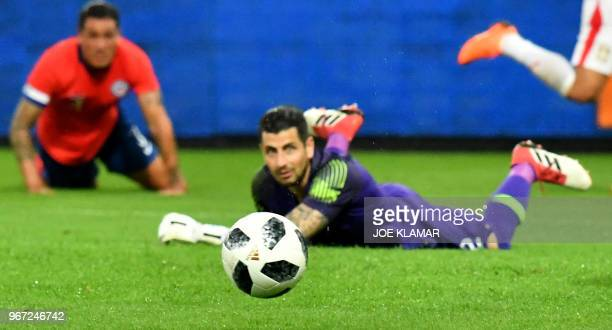 TOPSHOT Chile's goalkeeper Gabriel Arias eyes the ball during the international friendly football match Serbia v Chile at the Merkur Arena in Graz...