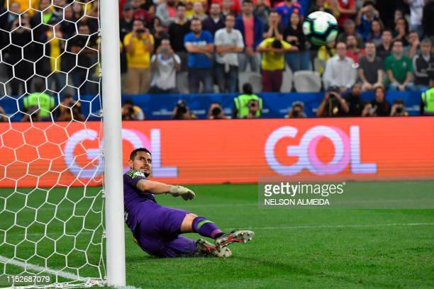 Chile's goalkeeper Gabriel Arias looks on as Colombia's William Tesillo sends his ball out during their penalty shootout after tying 00 during their...
