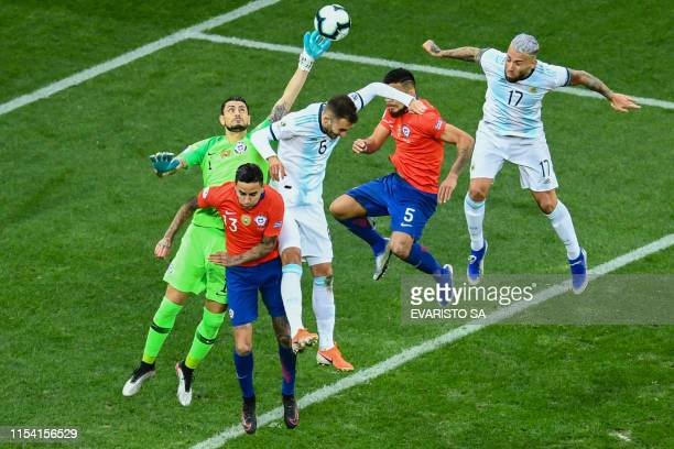TOPSHOT Chile's goalkeeper Gabriel Arias pulls off a save during the Copa America football tournament thirdplace match against Argentina at the...