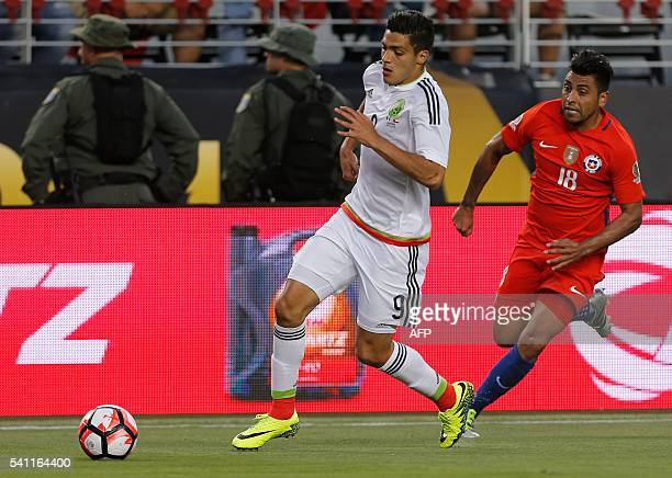 Chile's Gonzalo Jara vies for the ball with Mexico's Raul Jimenez during a Copa America Centenario quarterfinal football match in Santa Clara...