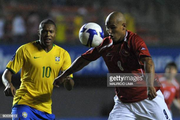 Chile´s Humberto Suazo gets ready to kick the ball near Brazil´s Julio Baptista during their FIFA World Cup South Africa2010 qualifier football match...