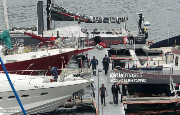 Chile's Investigations Police officers and crew members leave the SHK/Scallywag yacht after it arrived in Puerto Montt Chile on April 3 2018 to...