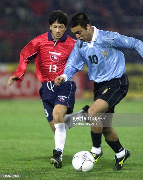 Chile's Jaime Valdez chases Uruguay's Alvaro Recoba 24 April 2001 in their 2002 World Cup elimination game in Santiago Uruguay defeated Chile 10