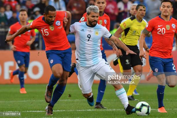 Chile's Jean Beausejour and Argentina's Sergio Aguero vie for the ball during their Copa America football tournament thirdplace match at the...