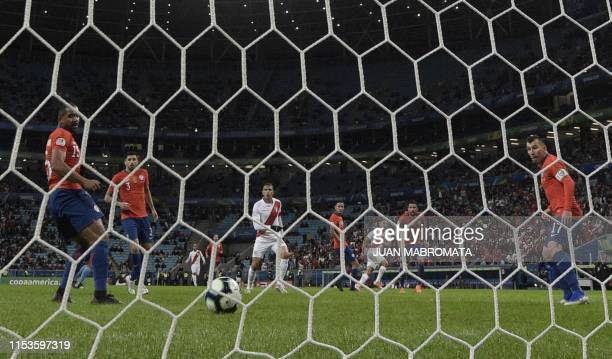 Chile's Jean Beausejour Guillermo Maripan and Gary Medel and Peru's Paolo Guerrero watch as the shot by Peru's Yoshimar Yotun goes into the goal...