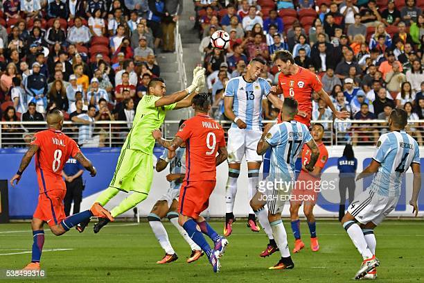 Chile's Jose Fuenzalida heads the ball to score against Argentina's Sergio Romero during a Copa America Centenario football match in Santa Clara...
