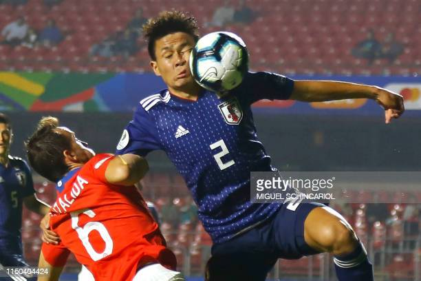 TOPSHOT Chile's Jose Pedro Fuenzalida and Japan's Daiki Sugioka battle for the ball during a Copa America football tournament Group C match between...
