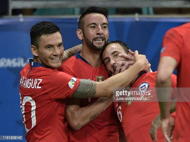 Chile's Jose Pedro Fuenzalida celebrates with teammates after scoring against Ecuador during their Copa America football tournament group match at...