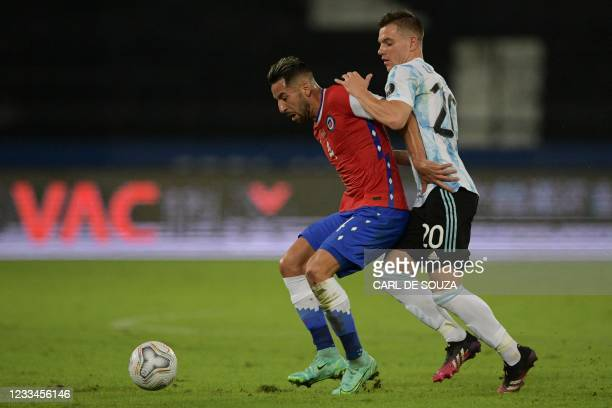 Chile's Mauricio Isla and Argentina's Giovani Lo Celso vie for the ball during their Conmebol Copa America 2021 football tournament group phase match...