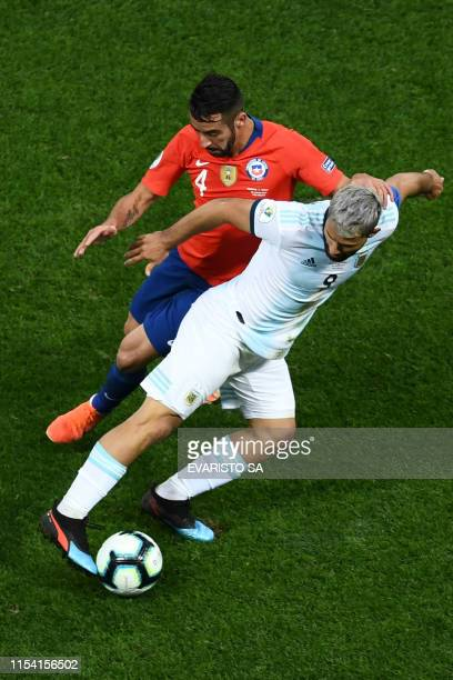 Chile's Mauricio Isla and Argentina's Sergio Aguero vie for the ball during their Copa America football tournament thirdplace match at the...